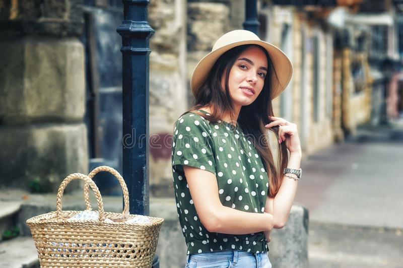 Happy young woman in casual wear on a street of a European city stock photography
