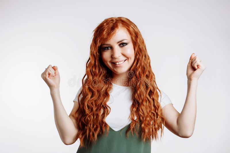 Happy young woman celebrating victory stock photo