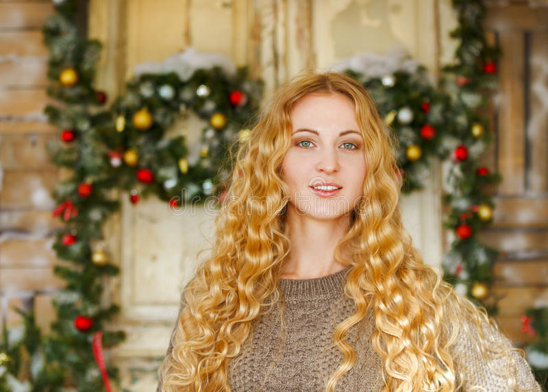 Happy young woman by the Christmas decorations. Portrait of the happy young woman by the Christmas decorations stock photos