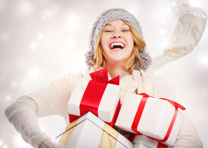 Happy Young Woman with Christmas Gifts stock photos