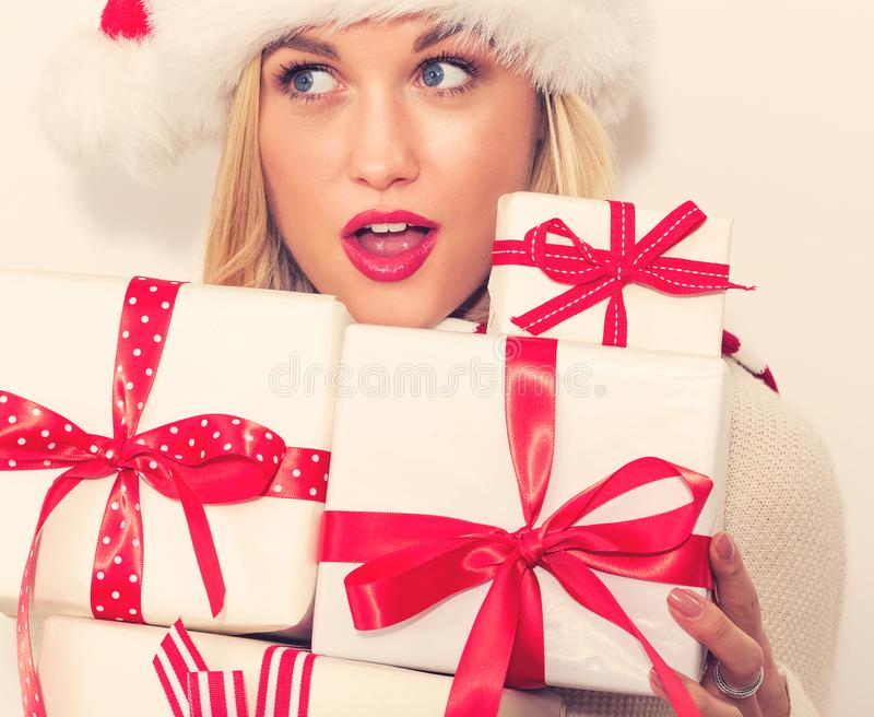 Happy young woman Christmas gifts royalty free stock photography