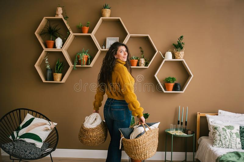 Happy young woman cleaning at home. Back view royalty free stock photo