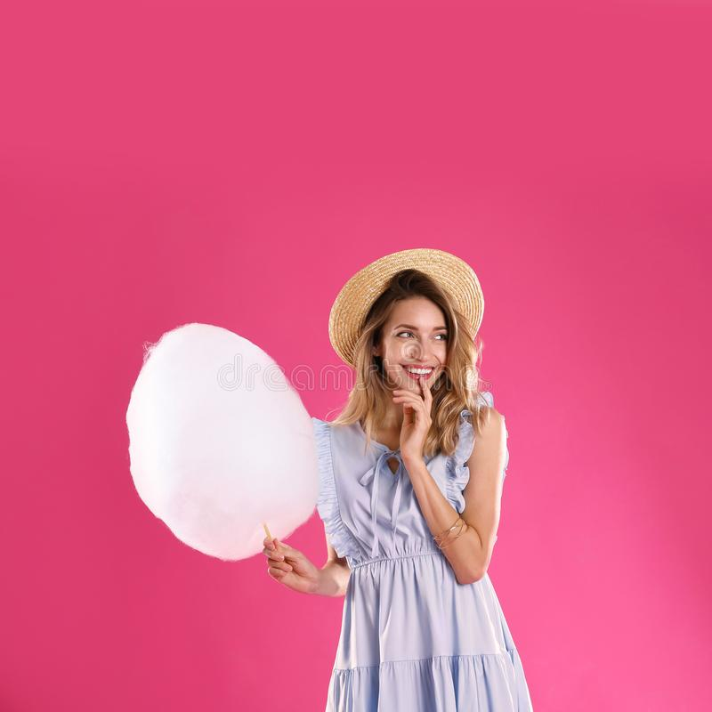 Happy young woman with cotton candy royalty free stock images