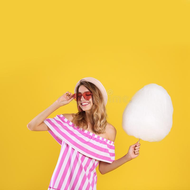 Happy young woman with cotton candy royalty free stock photo