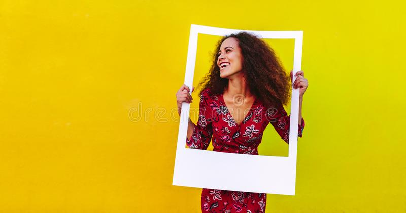 Pretty girl with big picture frame stock images