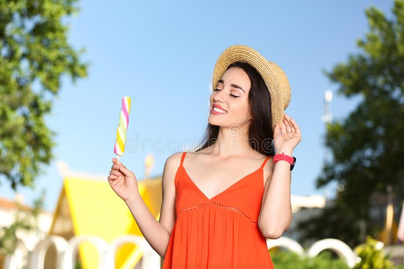 Happy young woman with delicious ice cream royalty free stock photography