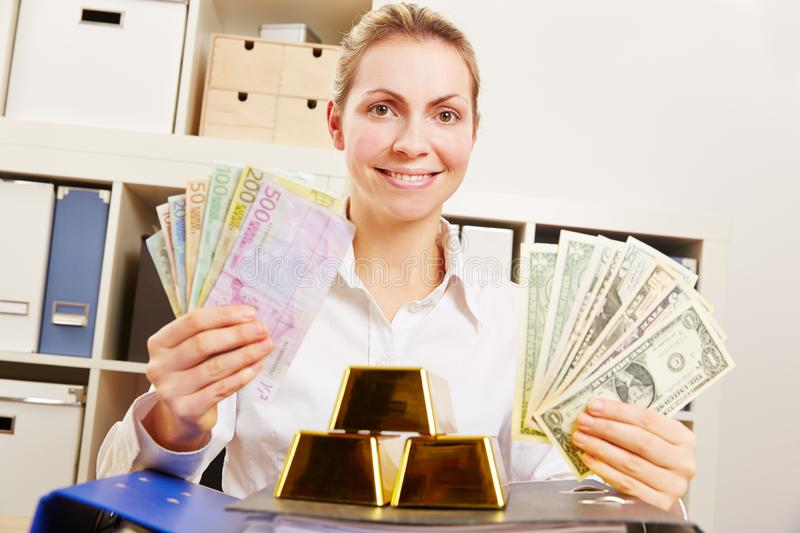 Woman with dollars and euros and gold royalty free stock photos