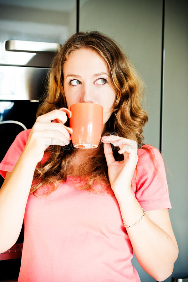 Happy Young Woman Drinking Coffee At Home In The Morni Stock Photography