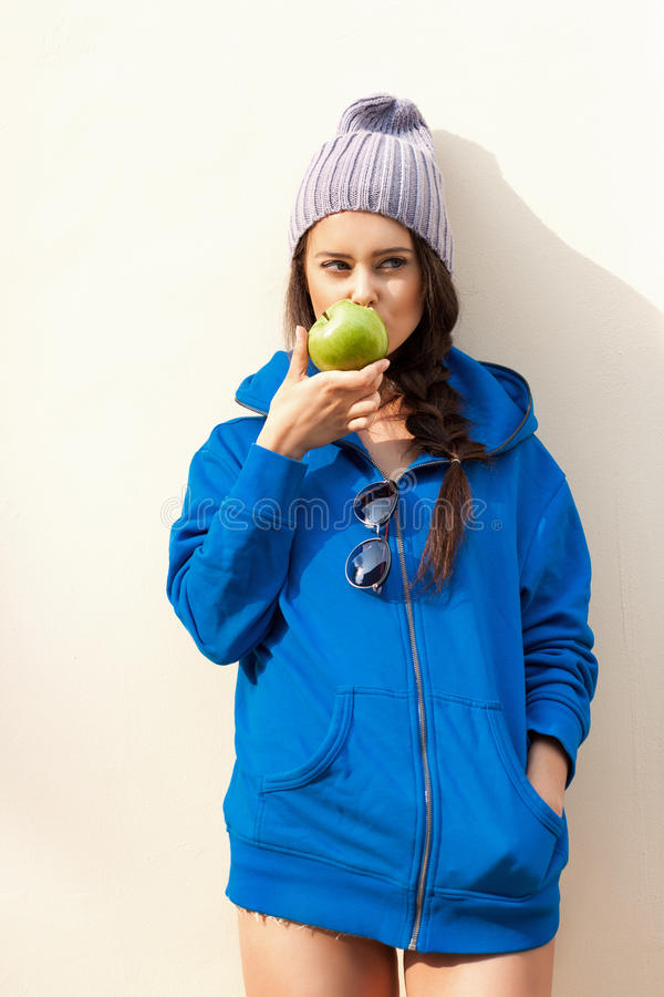 Download Happy Young Woman Eating Apple Stock Photo - Image: 34113320