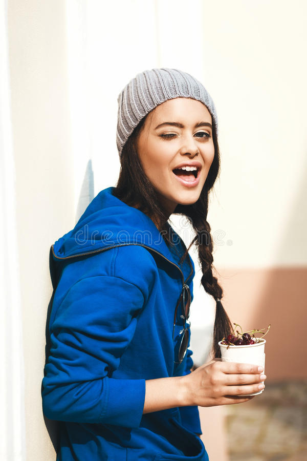Happy Young Woman Eating Cherry stock photos