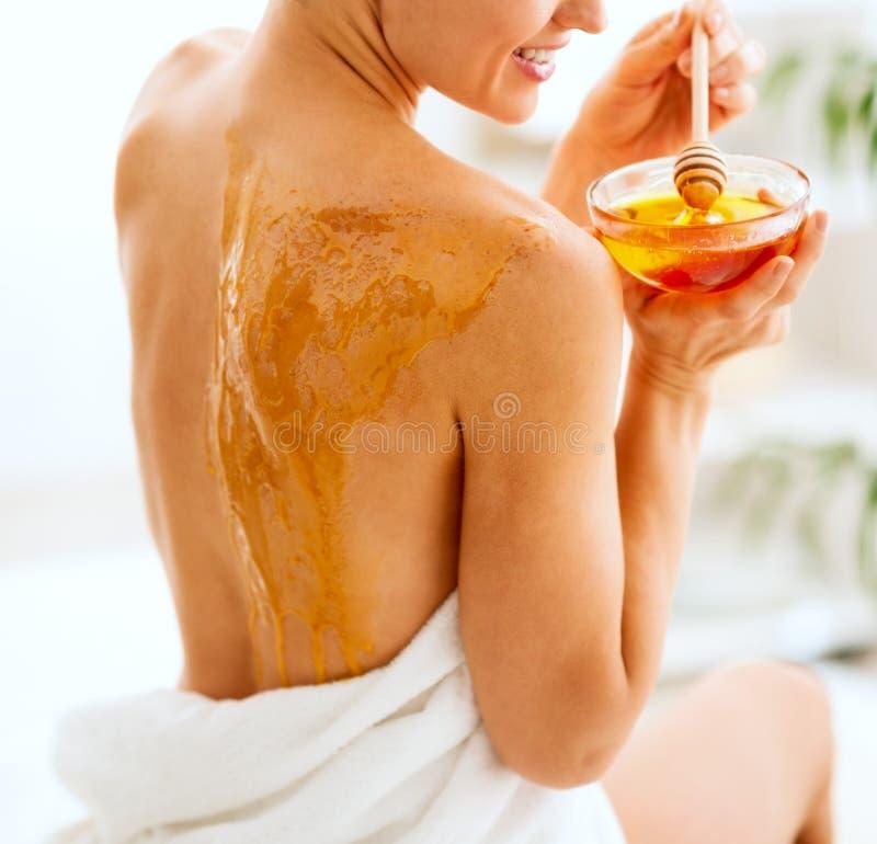 Young woman enjoying honey spa therapy stock photos