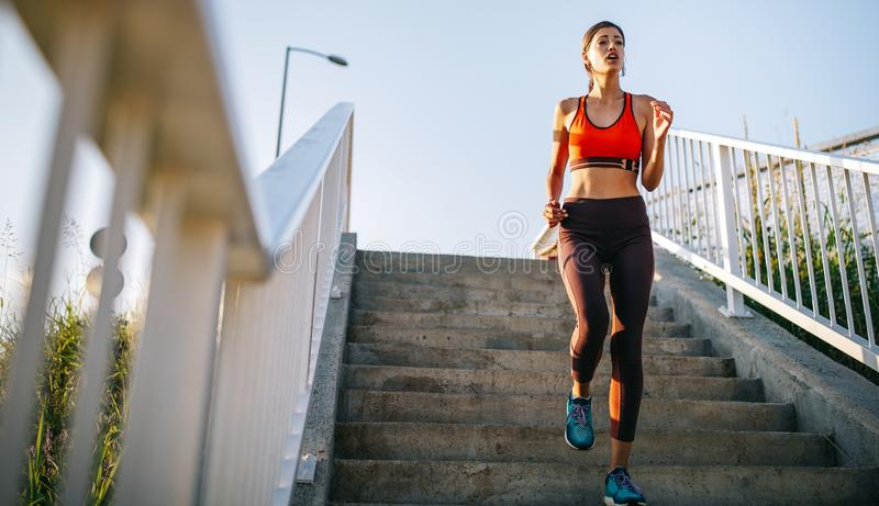 Happy young woman exercising outdoors. Living healthy life stock photos