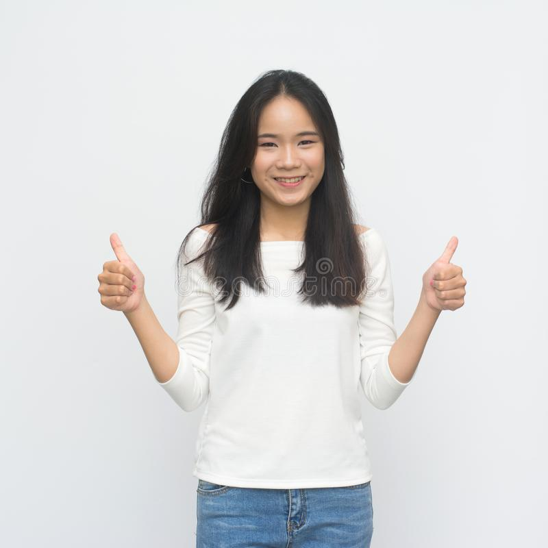 Happy young woman giving thumbs up royalty free stock photography