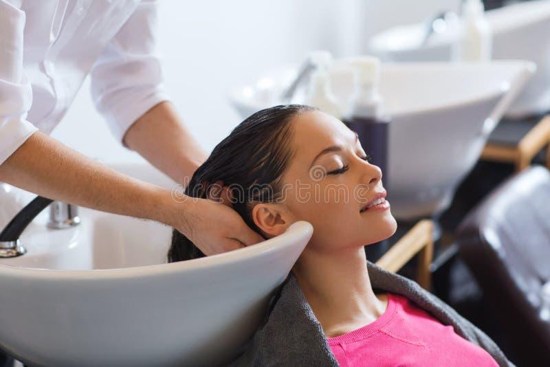 Happy young woman at hair salon stock photos