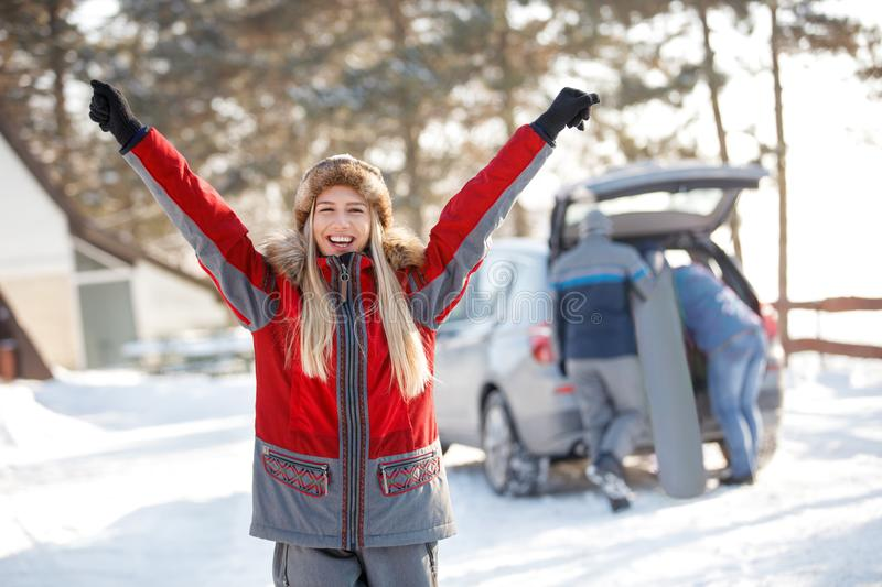 Happy woman with hands up enjoying in winter royalty free stock photography