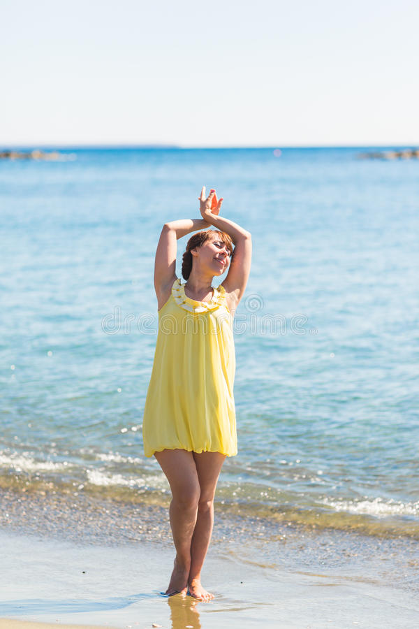 Happy young woman posing on the beach of sea stock photos