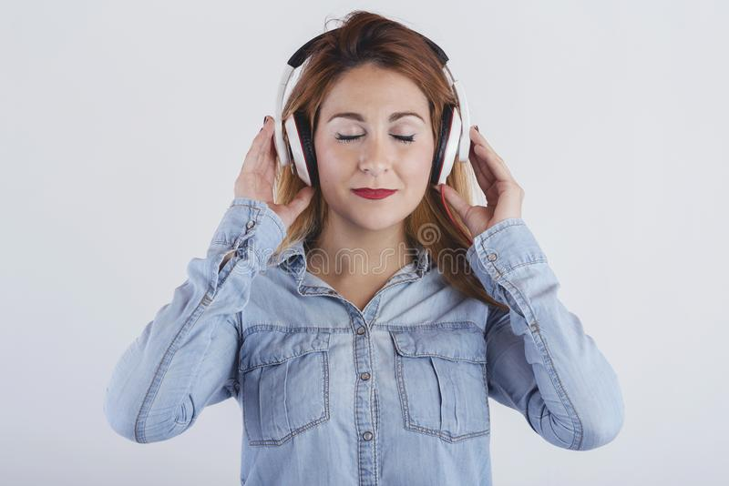 Happy young woman with headphones. On white backgroundn royalty free stock photography