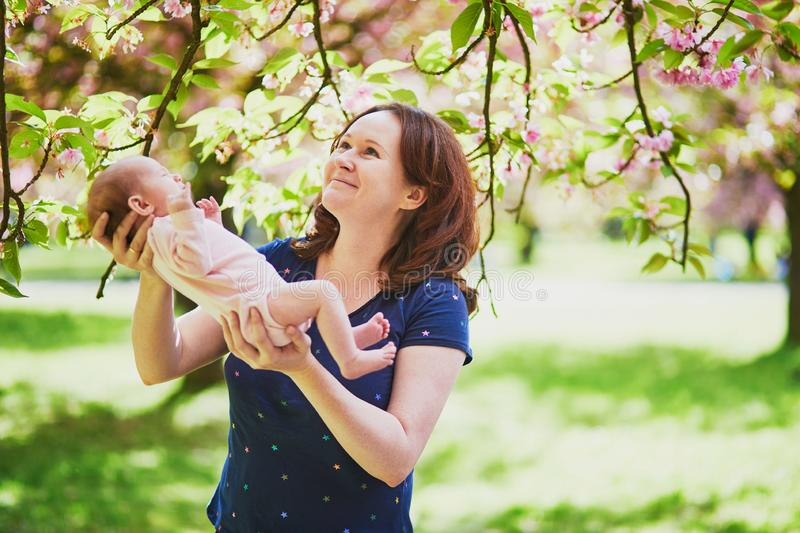 Happy young woman holding her little baby girl stock photography