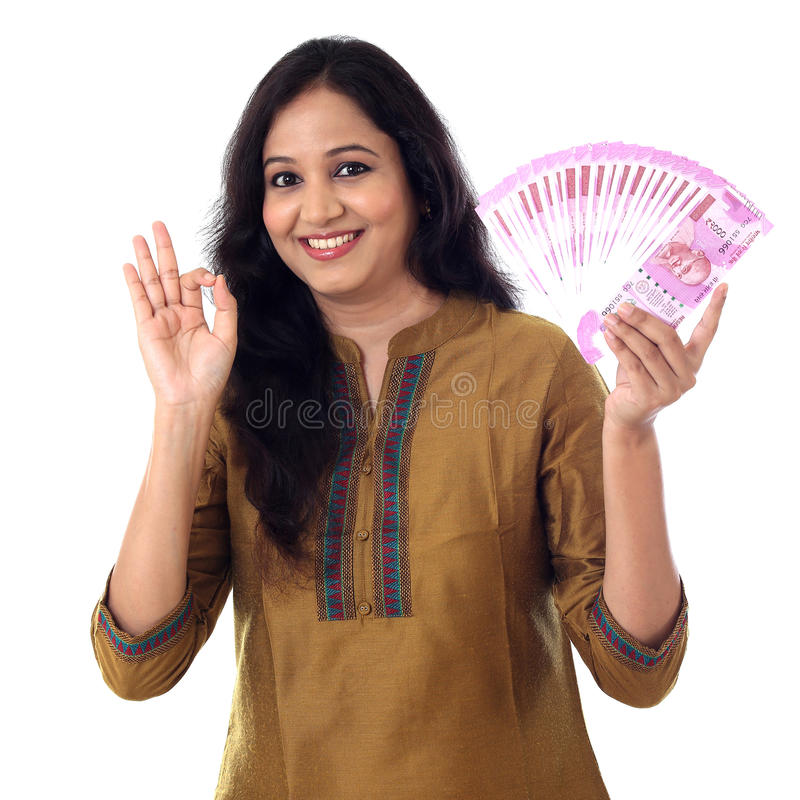 Happy young woman holding Indian 2000 rupee notes p stock photos