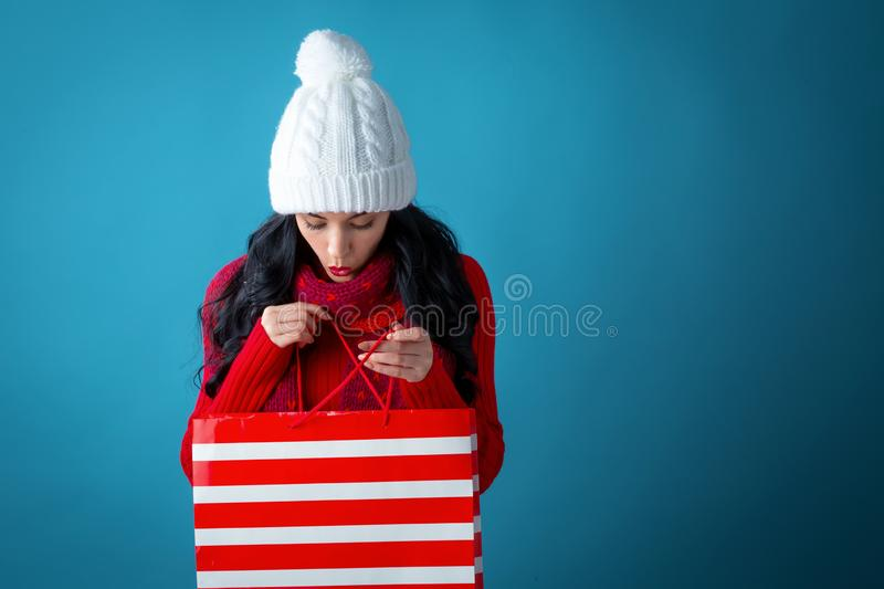 Happy young woman holding a shopping bag royalty free stock image