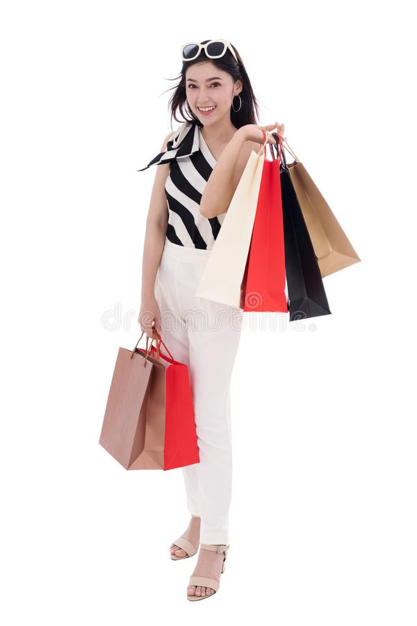 Happy young woman holding shopping bag isolated stock photography