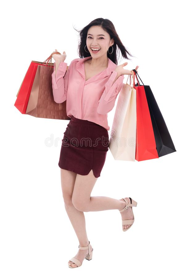 young woman holding shopping bag isolated on a white background stock image