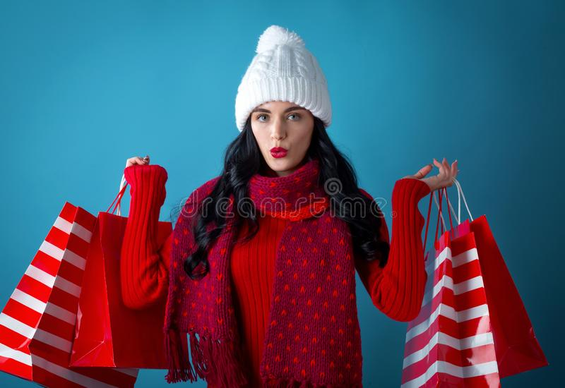 Happy young woman holding shopping bags royalty free stock photography