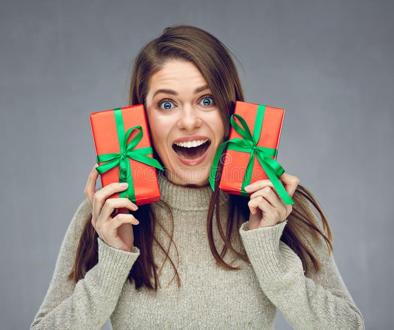Happy young woman holding two red gift box. royalty free stock image
