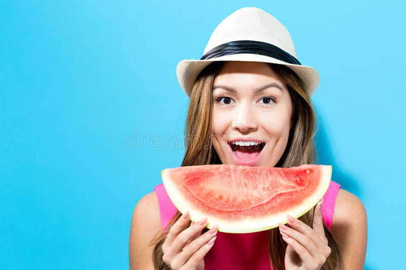 Happy young woman holding watermelon stock images