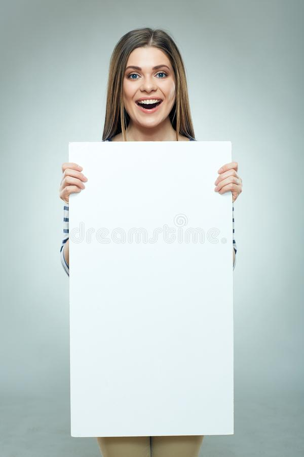 Happy young woman holding white sign board royalty free stock photos