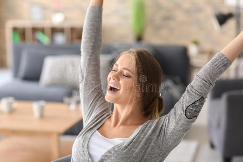 Happy young woman at home stock images
