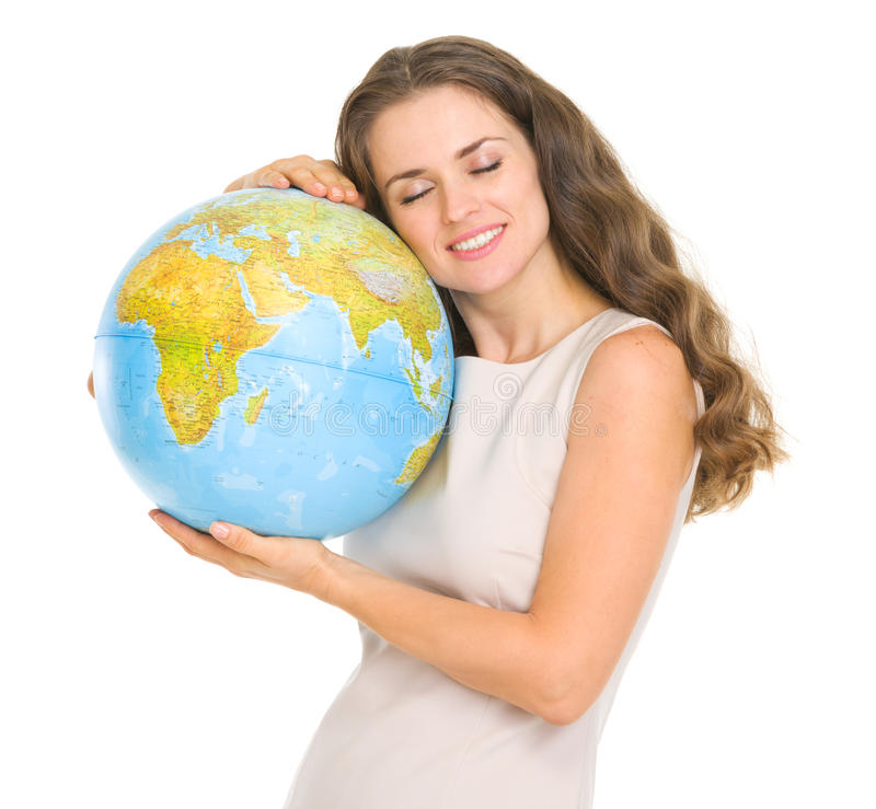 Happy young woman hugging globe stock photography