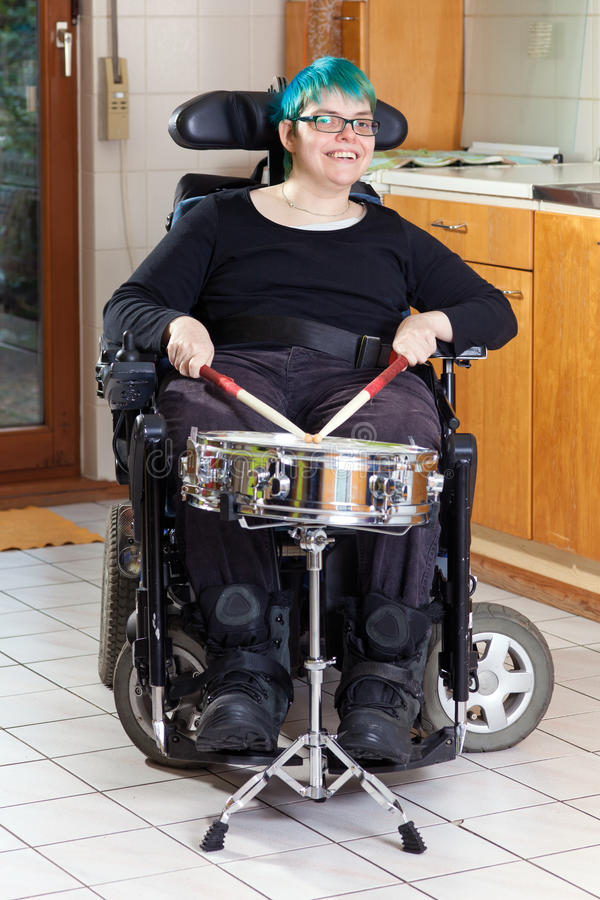 Happy young woman with infantile cerebral palsy. Happy spastic young woman with infantile cerebral palsy due to birth complications confined to a stock photo