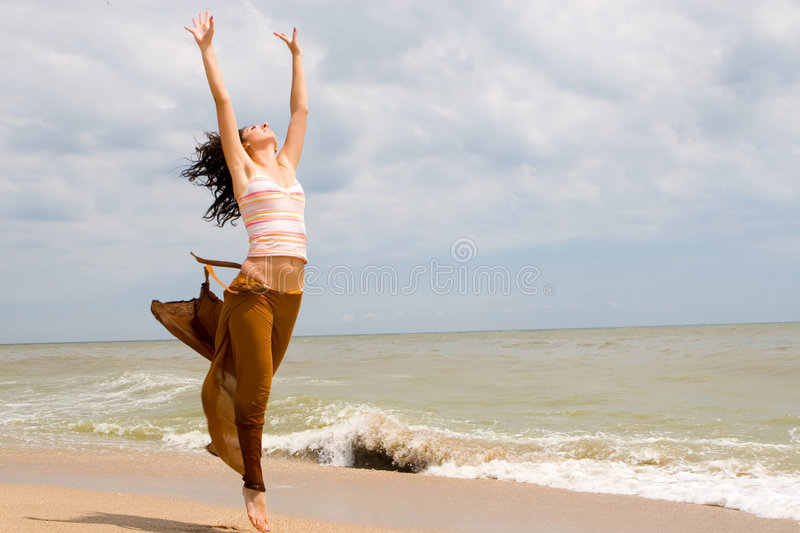 Download Happy Young Woman Is Jumping Stock Photo - Image: 7630860