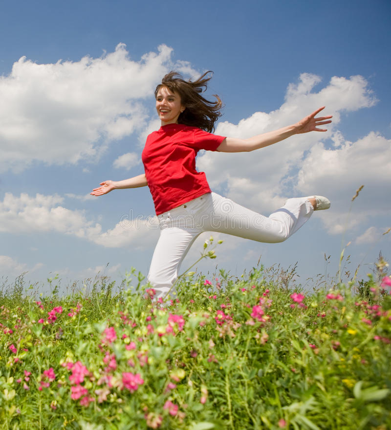 Download Happy young woman jumping stock image. Image of active - 9676667