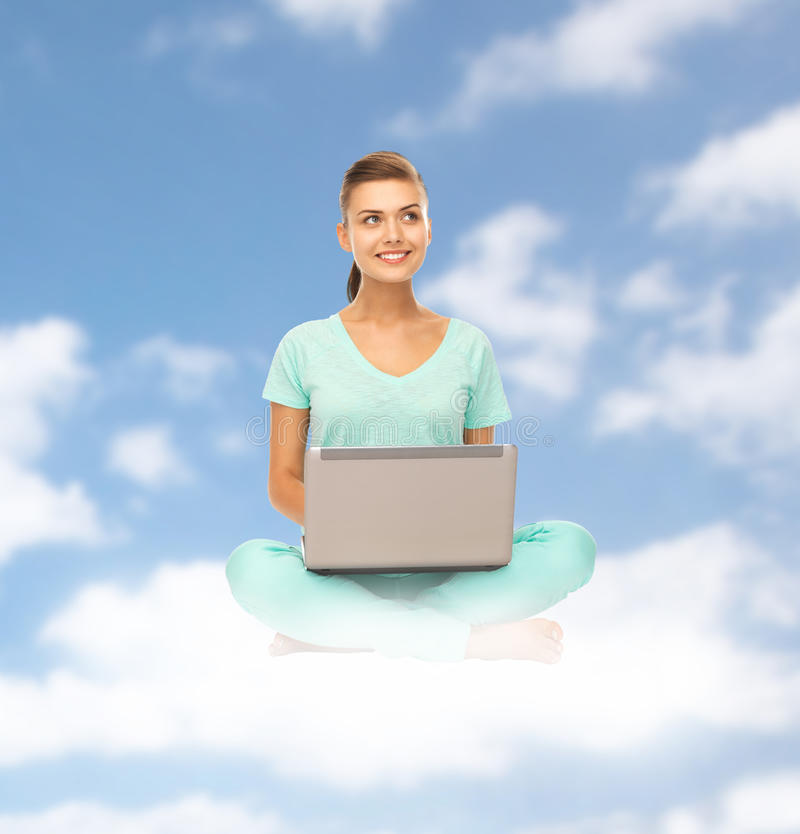 Happy young woman with laptop sitting on cloud stock images