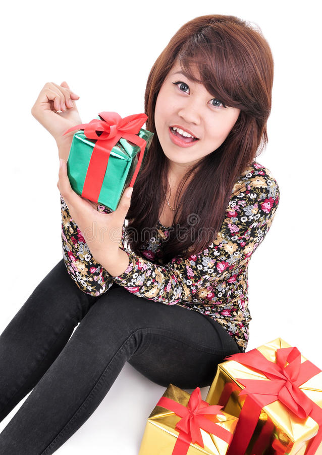 Happy young woman with lots of gifts. Isolated on white backgrou stock photography