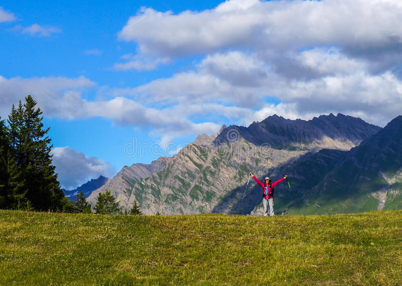 Happy young woman in the mountains. stock image