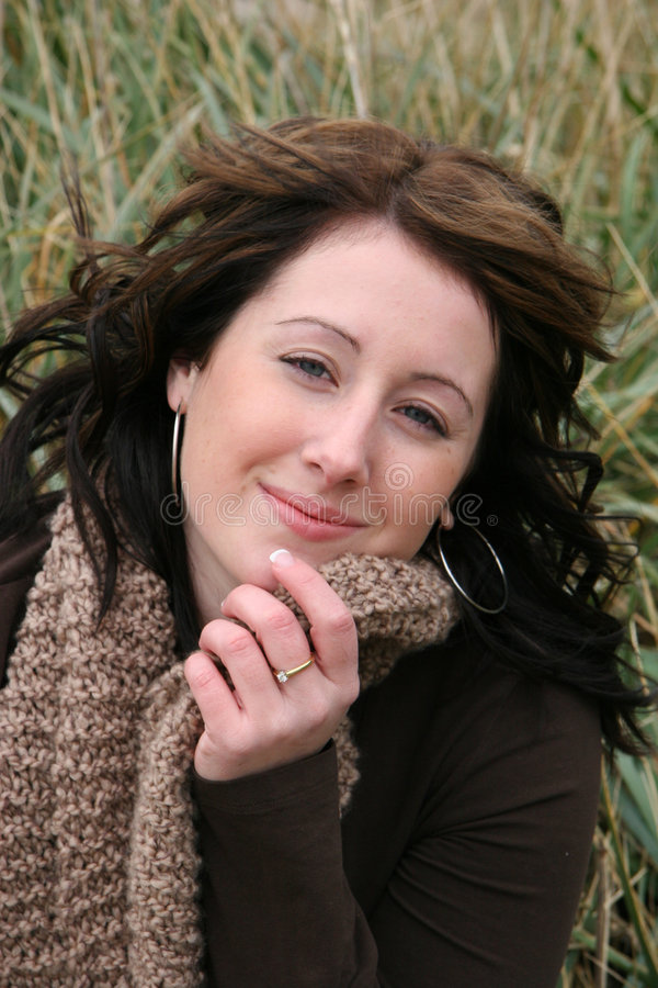 Happy young woman outdoors stock photography