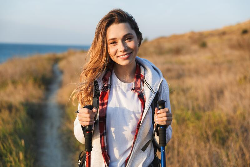 Happy young woman outside in free alternative vacation camping. Photo of happy young woman outside in free alternative vacation camping royalty free stock photography