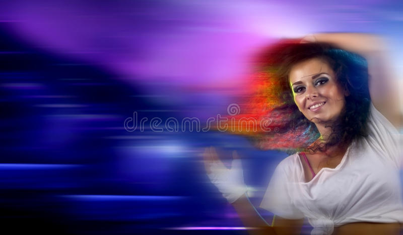 Happy young woman partying stock photo