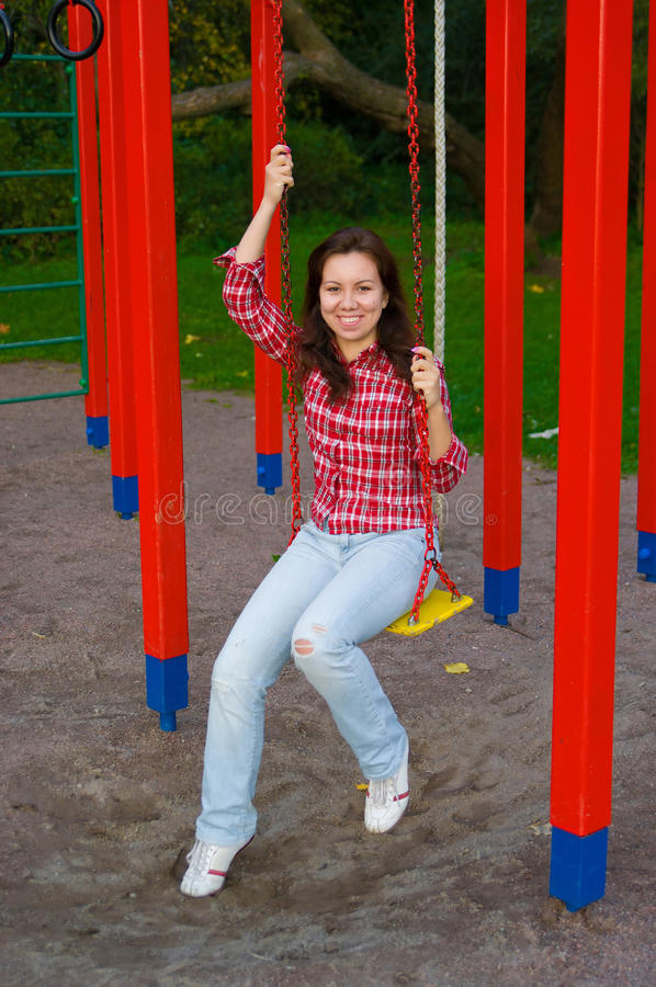 Happy young woman on playground stock photo