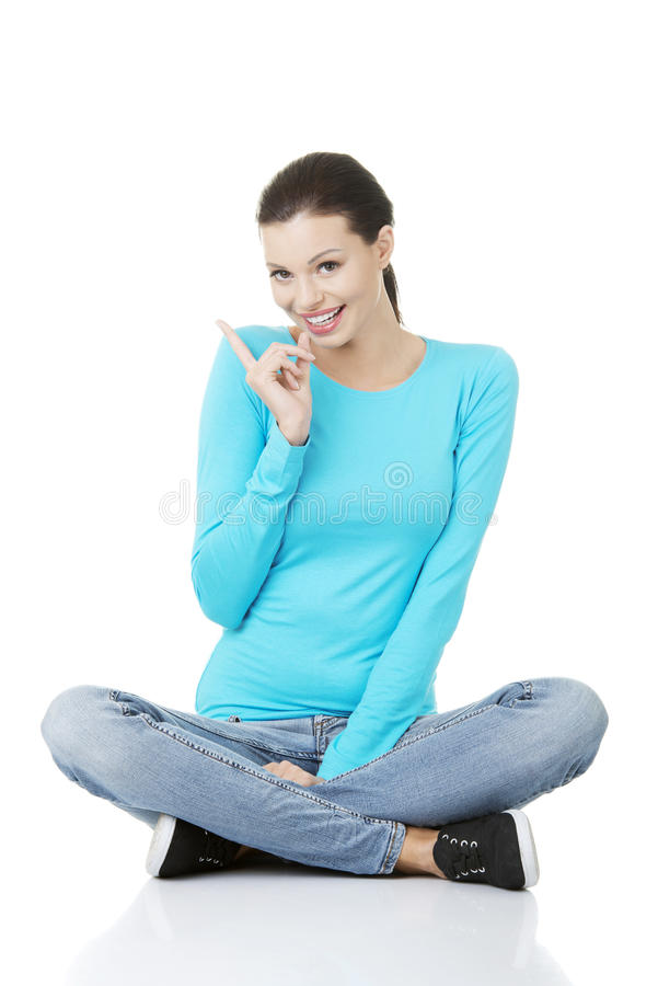 Download Happy Young Woman Pointing On Copy Space. Royalty Free Stock Photos - Image: 28203698