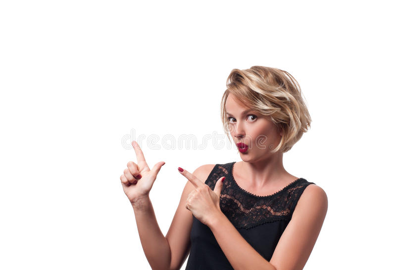 Happy young woman pointing up. stock images