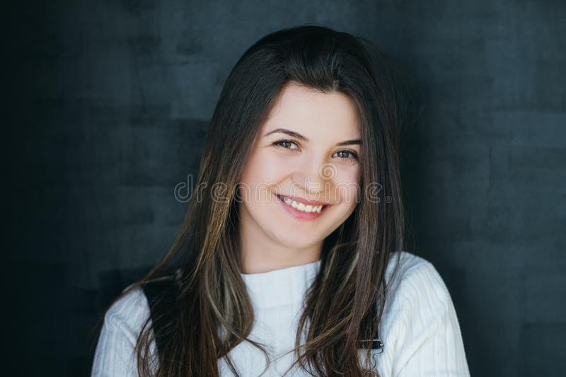 Happy young woman brunette youth friendliness. Happy young woman portrait. Smiling beautiful brunette with long hair looking at camera. Carefree youth and royalty free stock image