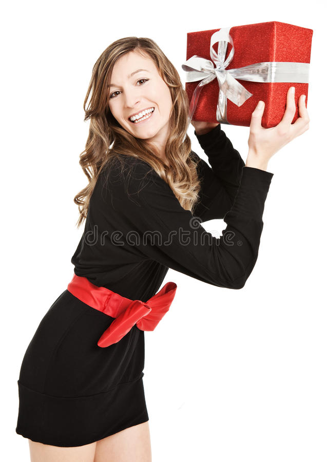 Happy young woman with a present royalty free stock photography