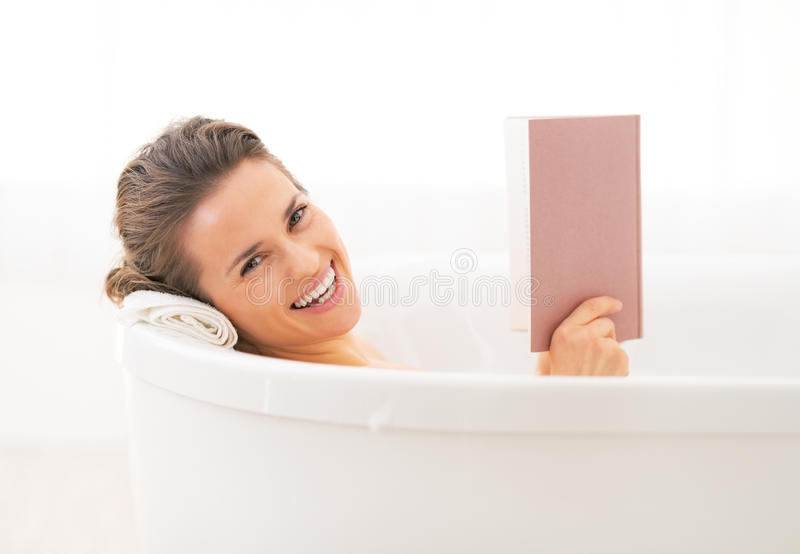 Happy Young Woman Reading Book In Bathtub Stock Photo - Image of ...