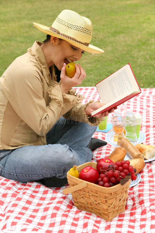 Happy Young Woman Reading Book Outdoor stock photo