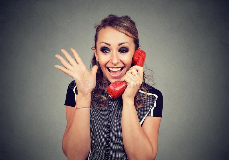 Happy woman receiving good news winning on the phone. Happy young woman receiving good news winning on the phone stock photos
