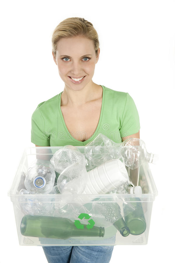 Happy young woman recycling royalty free stock images